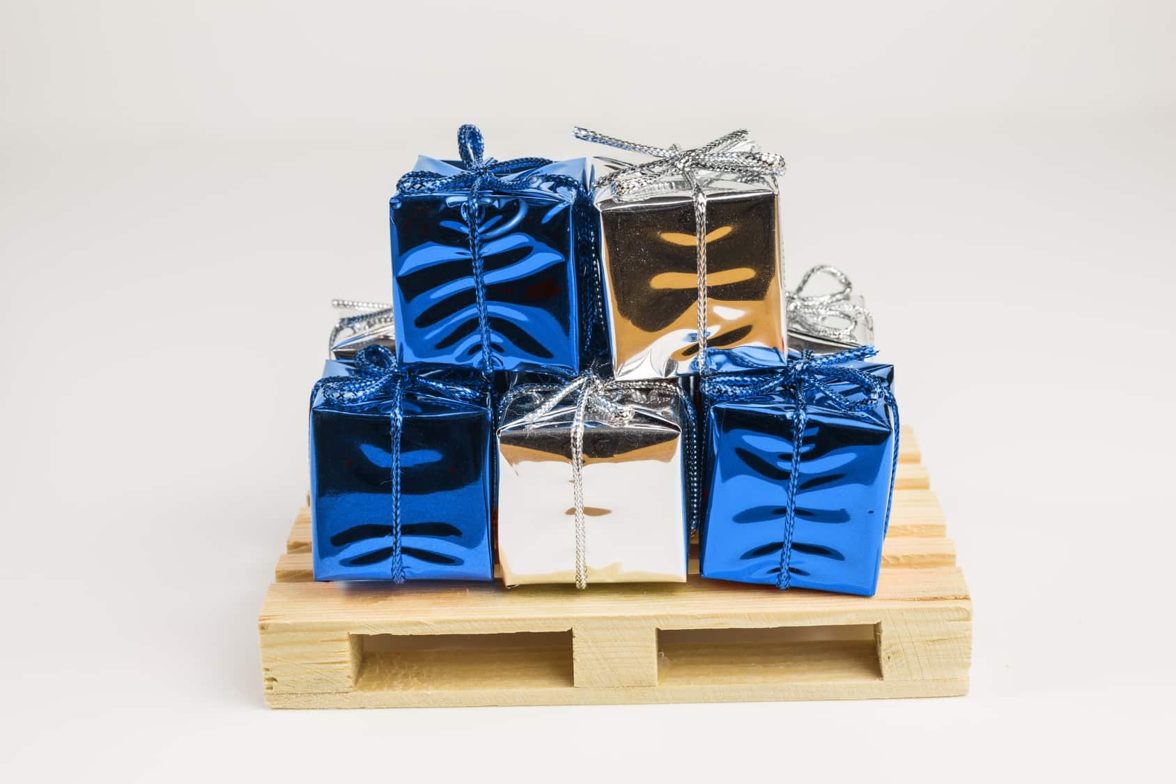 gift boxes in red and silver on mini wooden pallet
